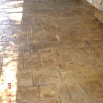 Notched Old English Ashlar Slate pattern. Stamped Concrete, Acid Stained